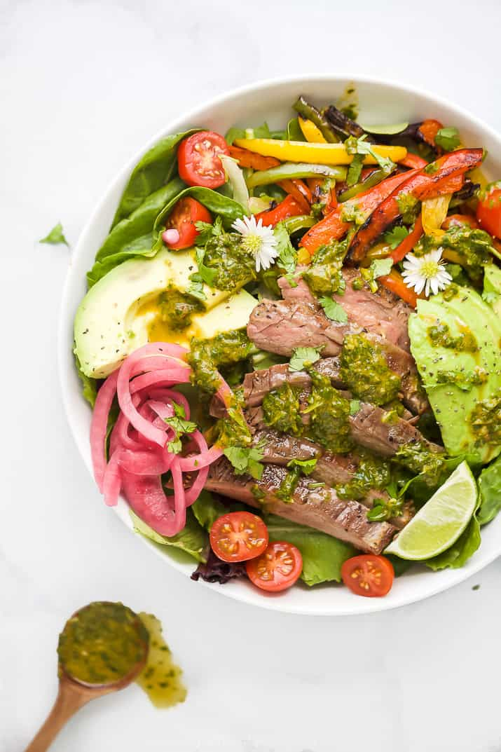 grilled fajita steak salad with chimichurri dressing in a bowl