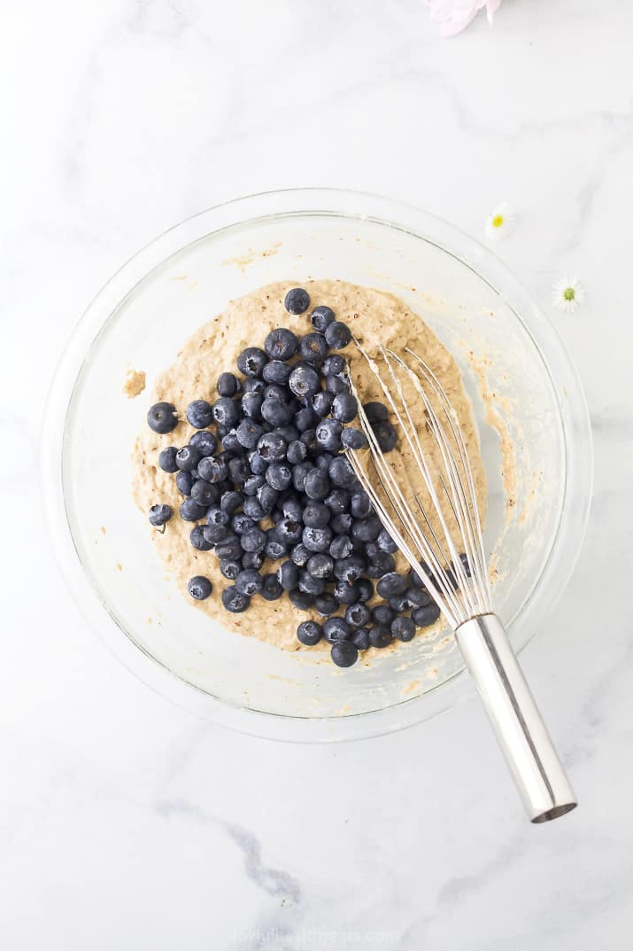 healthy vegan pancake batter with blueberries in a bowl