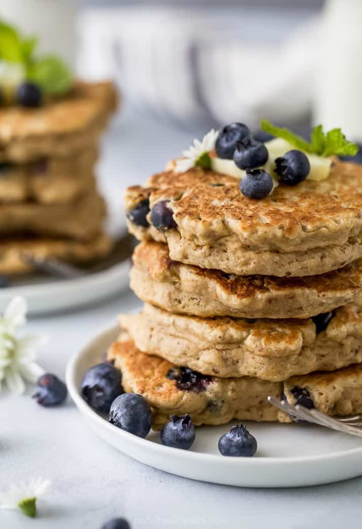 close up photo of healthy vegan blueberry pancakes on a plate