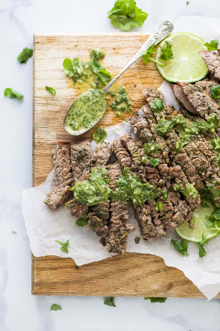 the best marinated grilled flank steak on a cutting board