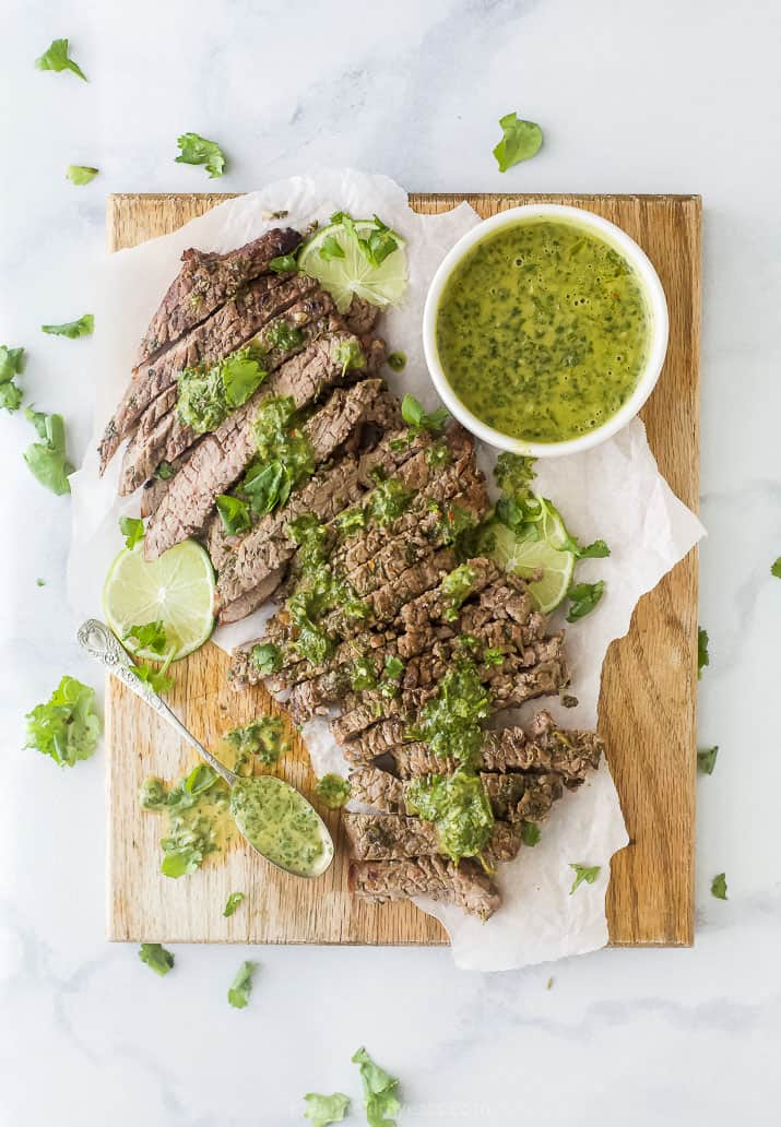 overhead photo of the best marinated grilled flank steak recipe with chimichurri sauce