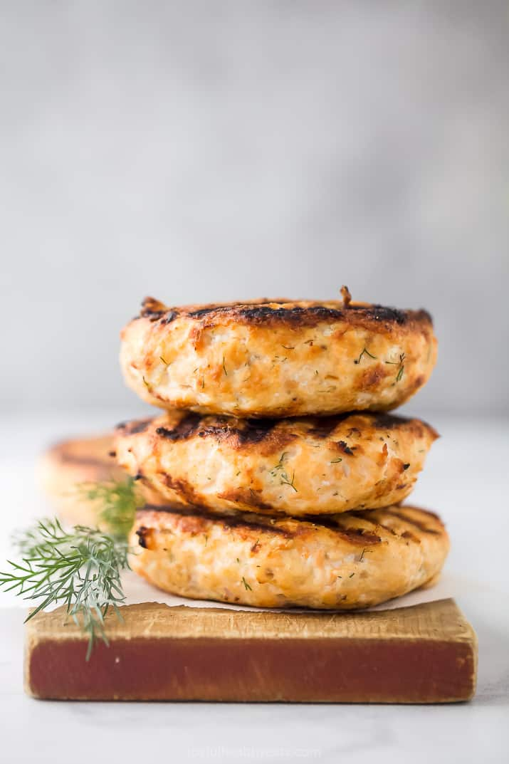 a stack of grilled salmon burgers