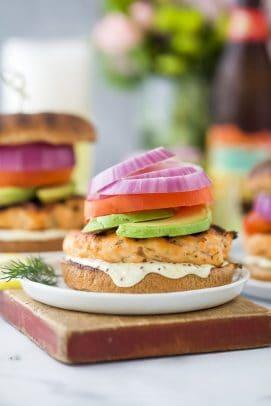 grilled salmon burger with lemon garlic aioli on a bun