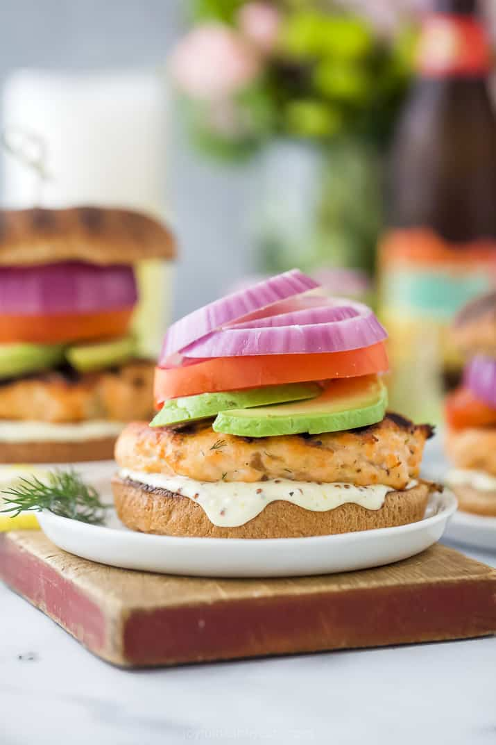 grilled salmon burger with lemon garlic aioli on a bun