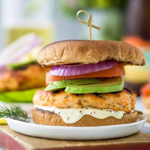 best grilled salmon burger topped with tomato, avocado, red onion and lemon garlic aioli