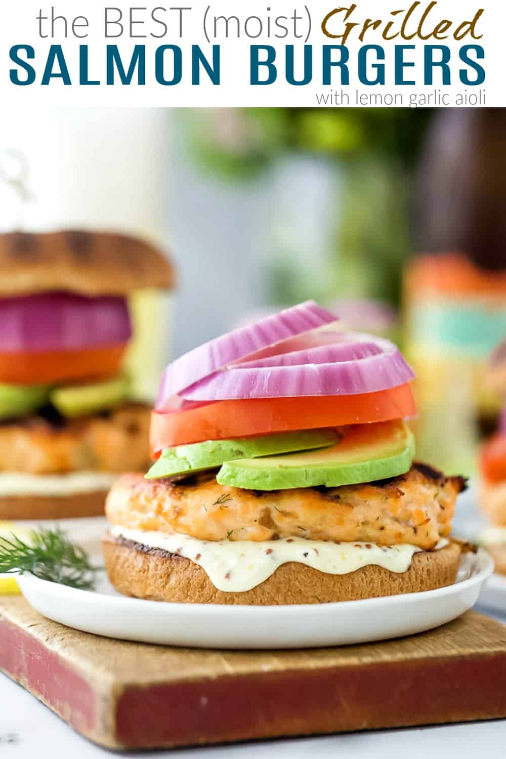 pinterest image for the best grilled salmon burgers with lemon garlic aioli