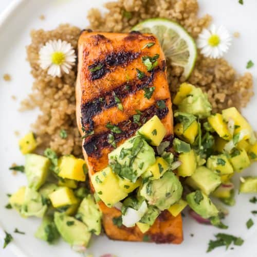 close up overhead photo of easy chili lime grilled salmon with mango avocado salsa on a plate