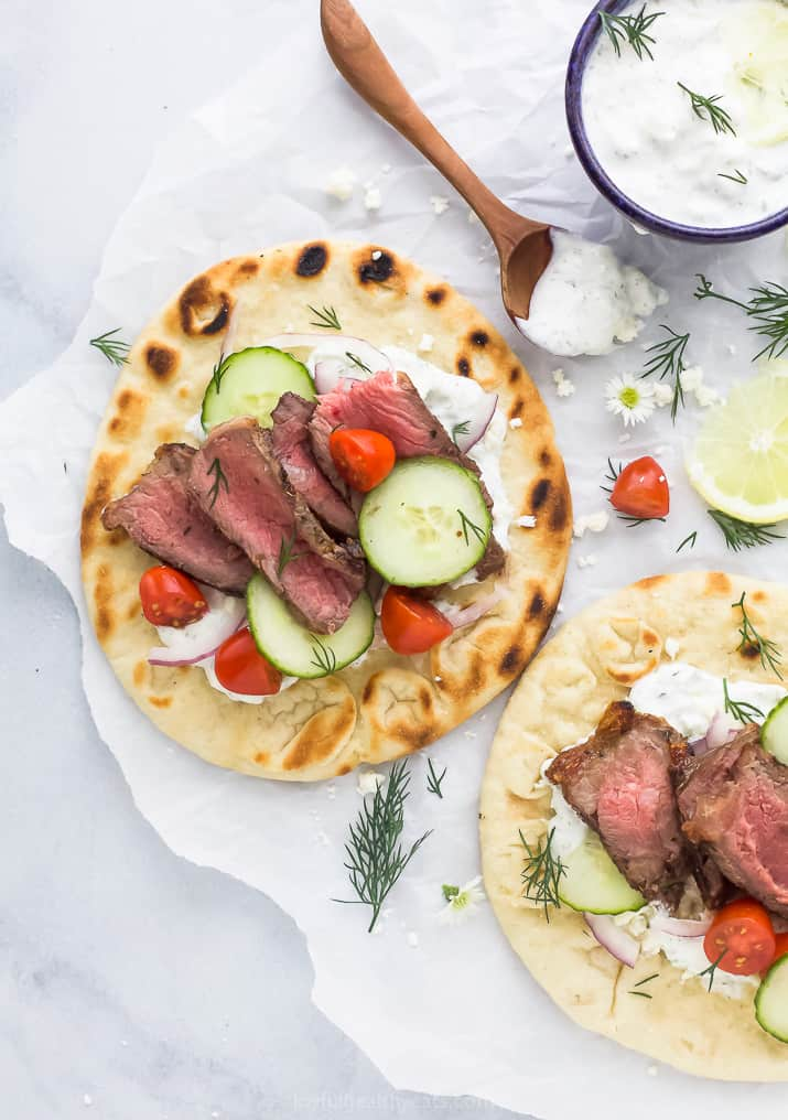 easy grilled steak gyros with tzatziki sauce and vegetables