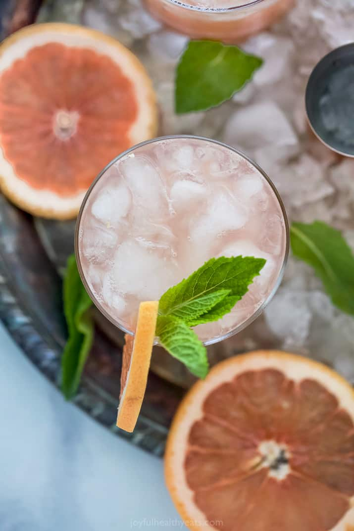overhead of a grapefruit salty dog drink in a glass garnished with grapefruit slice