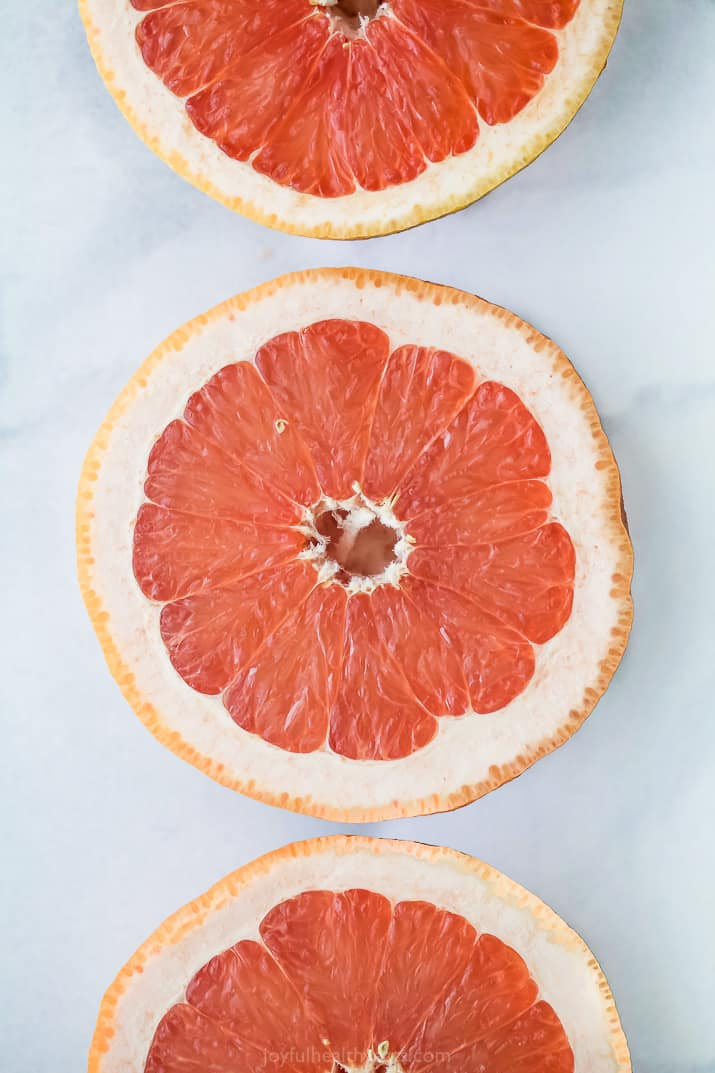 grapefruit halves on a board