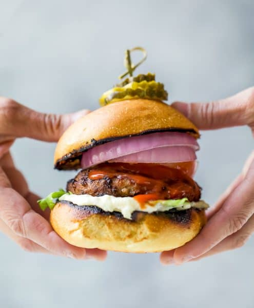 ultimate classic turkey burger being held with hands