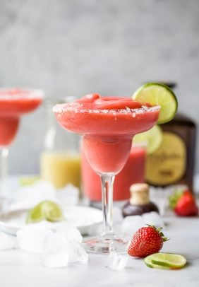 photo of the ultimate blender frozen strawberry margaritas in a glass with a lime