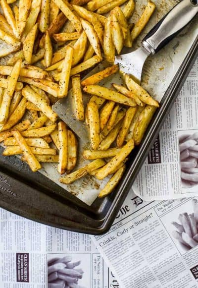 crispy baked fries on a baking sheet