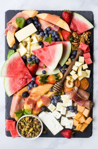 overhead photo of a summer fruit and cheese board