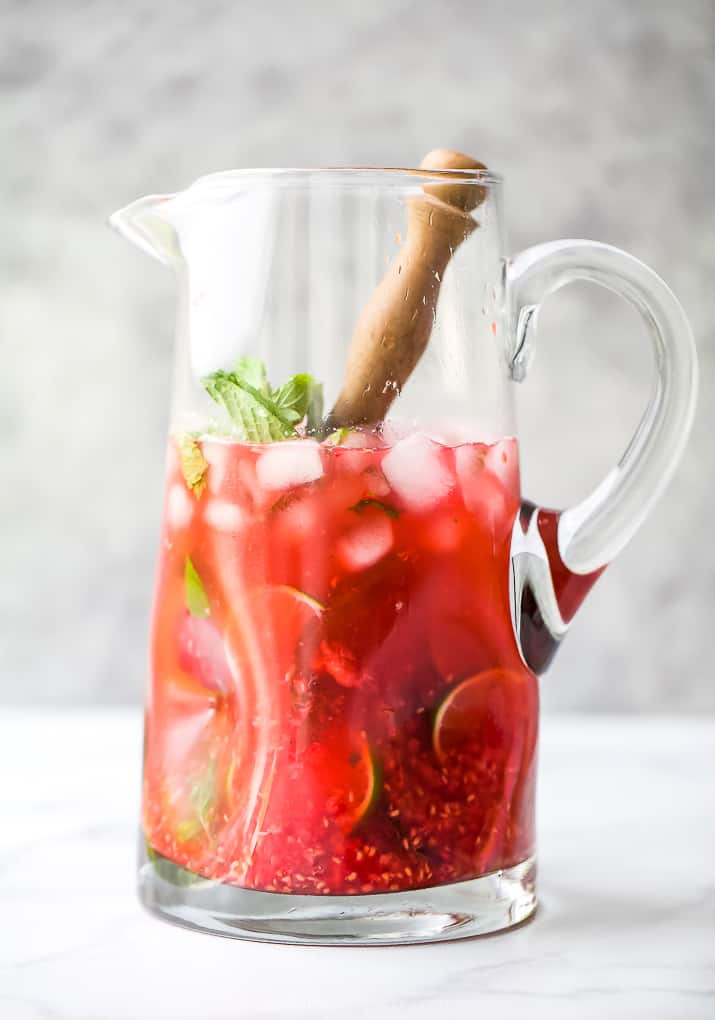 the best fresh raspberry mojito recipe in a pitcher