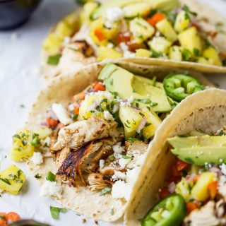 close up photo of easy chipotle chicken tacos topped with pineapple salsa