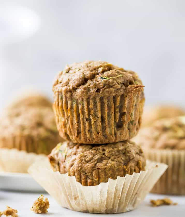 close up of two healthy zucchini muffins stacked on top of each other