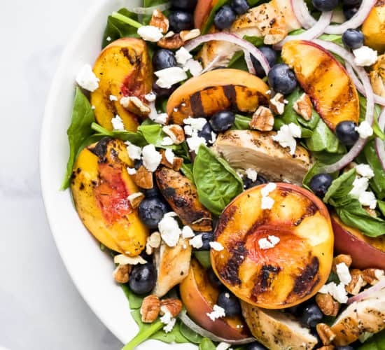 grilled peach chicken salad in a bowl
