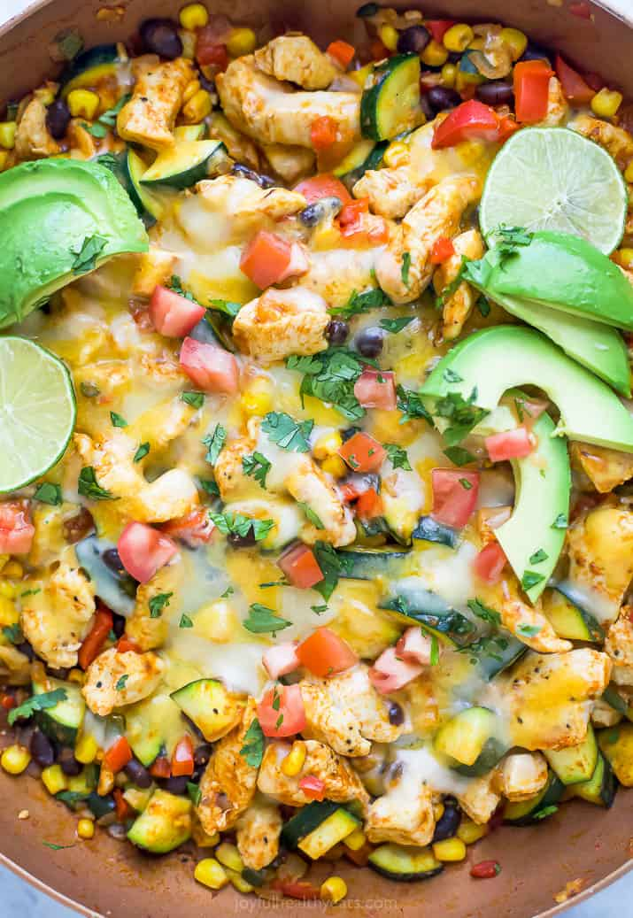 closeup photo of 30 minute zucchini chicken enchilada skillet with avocados on top