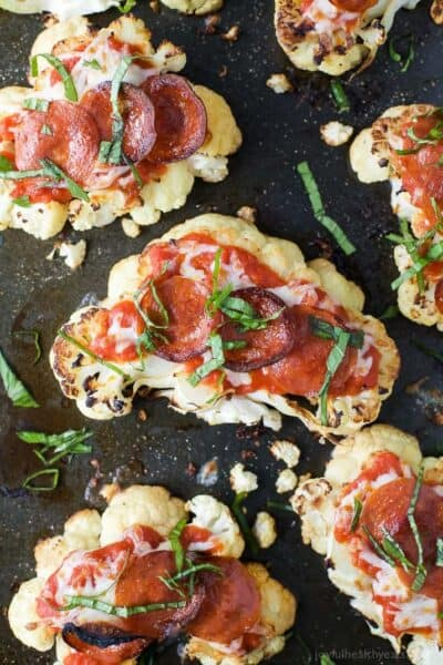 cauliflower steak pepperoni pizzas topped with fresh basil