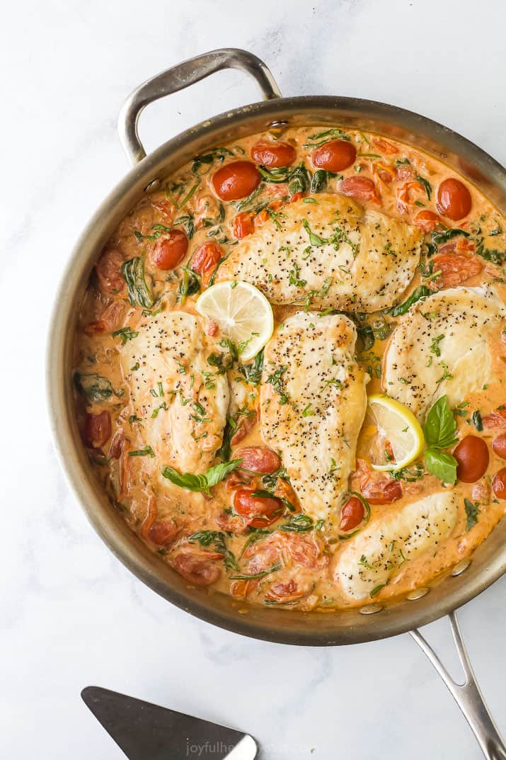 overhead photo of easy 30 minute creamy tuscan chicken in a pan