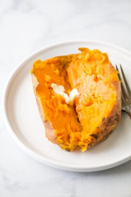 close up photo of instant pot sweet potato cut in half with butter