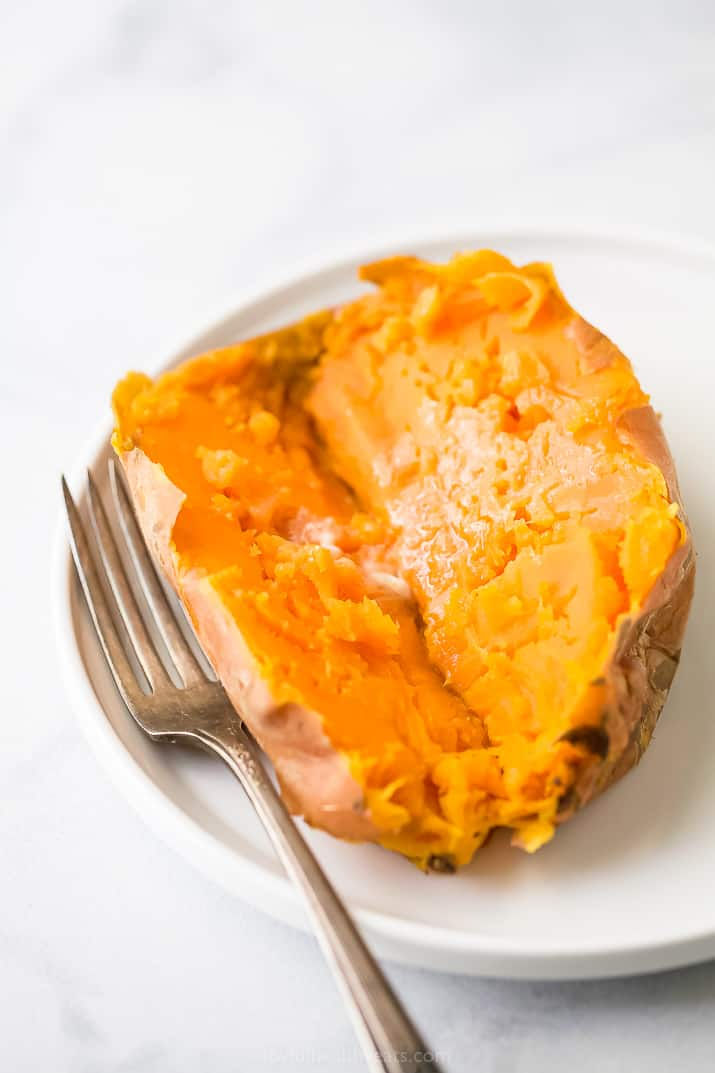 sweet potatoes cooked in a instant pot on a plate with butter and a fork