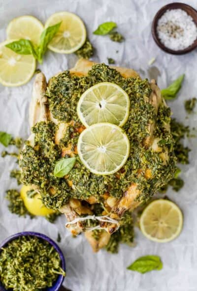 instant pot pesto rotisserie chicken topped with pesto and lemons
