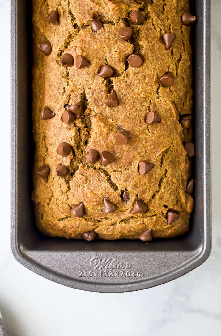 healthy banana pumpkin bread with chocolate chips in a loaf pan
