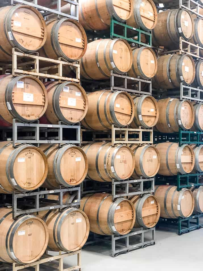 wine barrels stacked in a cooling area at a winery in napa valley california