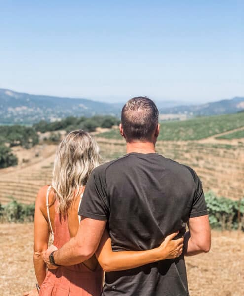 a couple overlooking a vineyard in Sonoma County