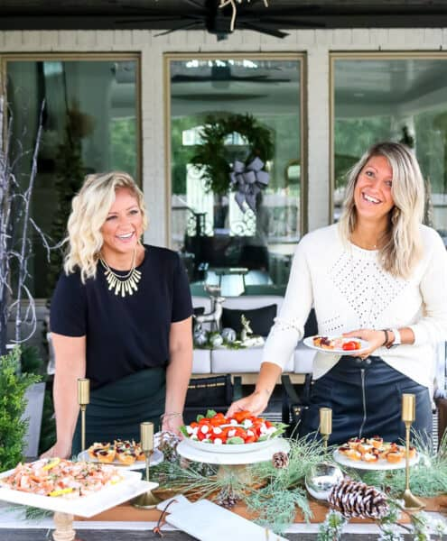 photo of two women setting a holiday entertaining table