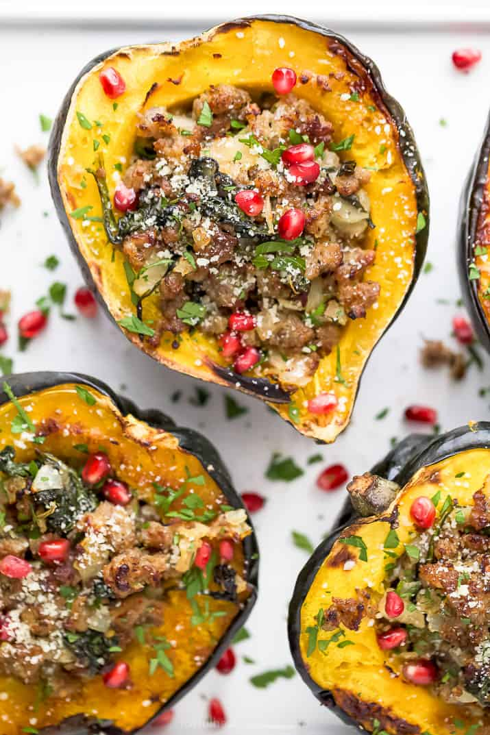 close up photo of apple sausage stuffed acorn squash