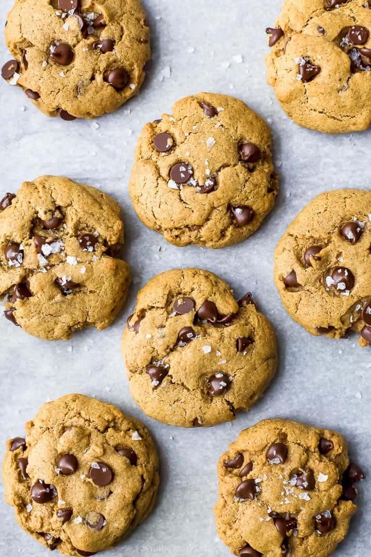 overhead photo of freshly baked vegan pumpkin chocolate chip cookies