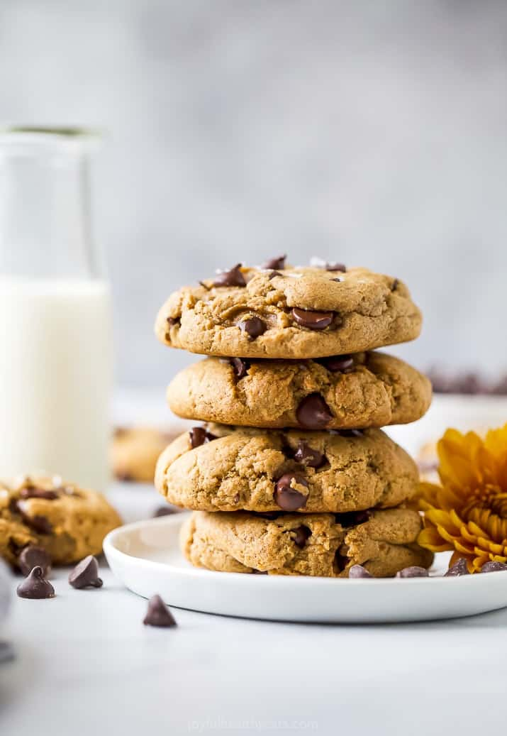 epic vegan pumpkin chocolate chip cookies stacked on top of each other