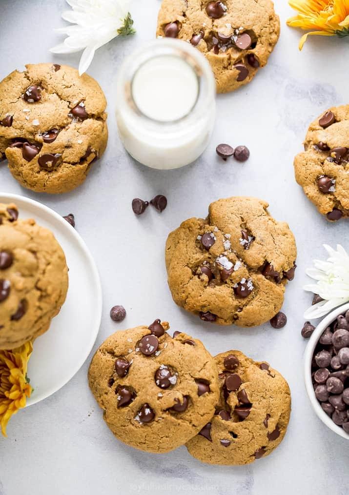 overhead photo of vegan pumpkin chocolate chip cookies with milk