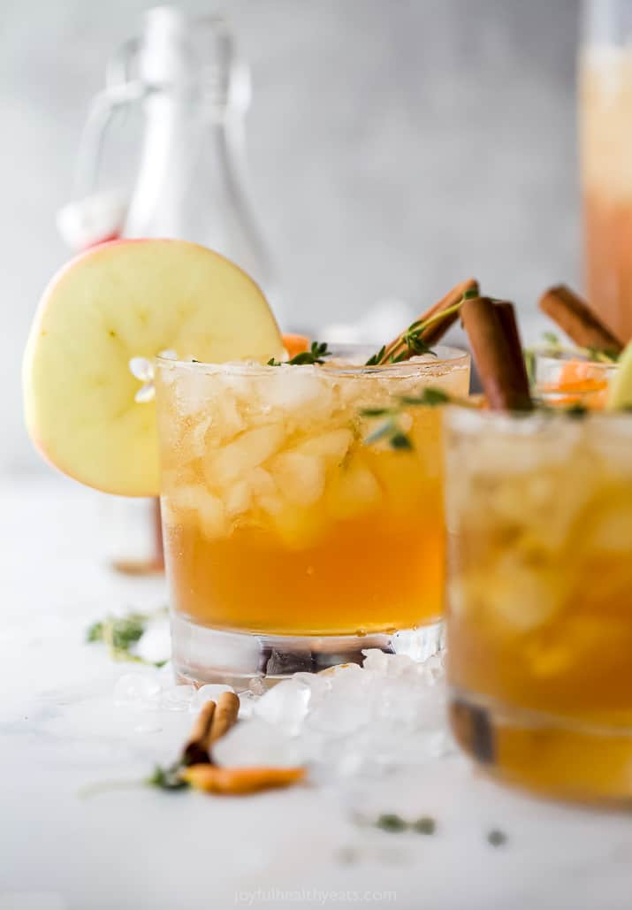 harvest apple bourbon cocktail in a glass with cinnamon stick