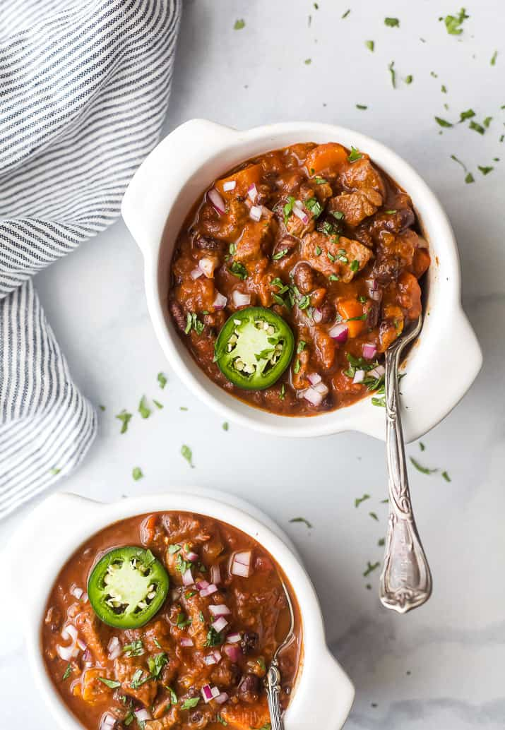 overhead photo of the best instant pot chili recipe with steak in bowls