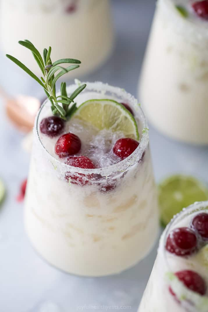 close up of white christmas margarita recipe in a glass and garnished