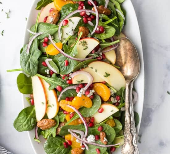 best spinach salad with apple pecans and gorgonzola cheese on a plate