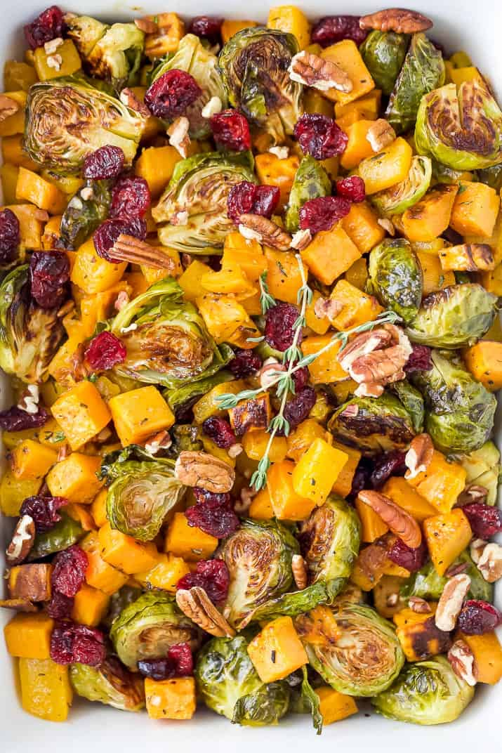 close up photo of maple dijon roasted butternut squash brussel sprout salad