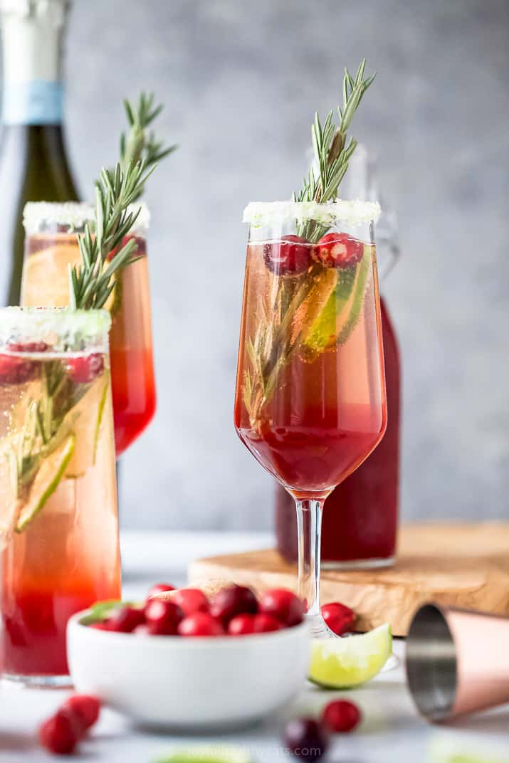 easy cranberry mimosa recipe in a glass with garnish