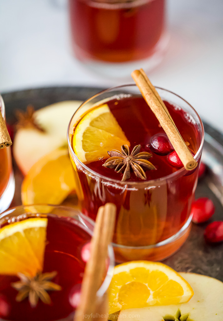 close up photo of festive spiked cranberry mulled apple cider