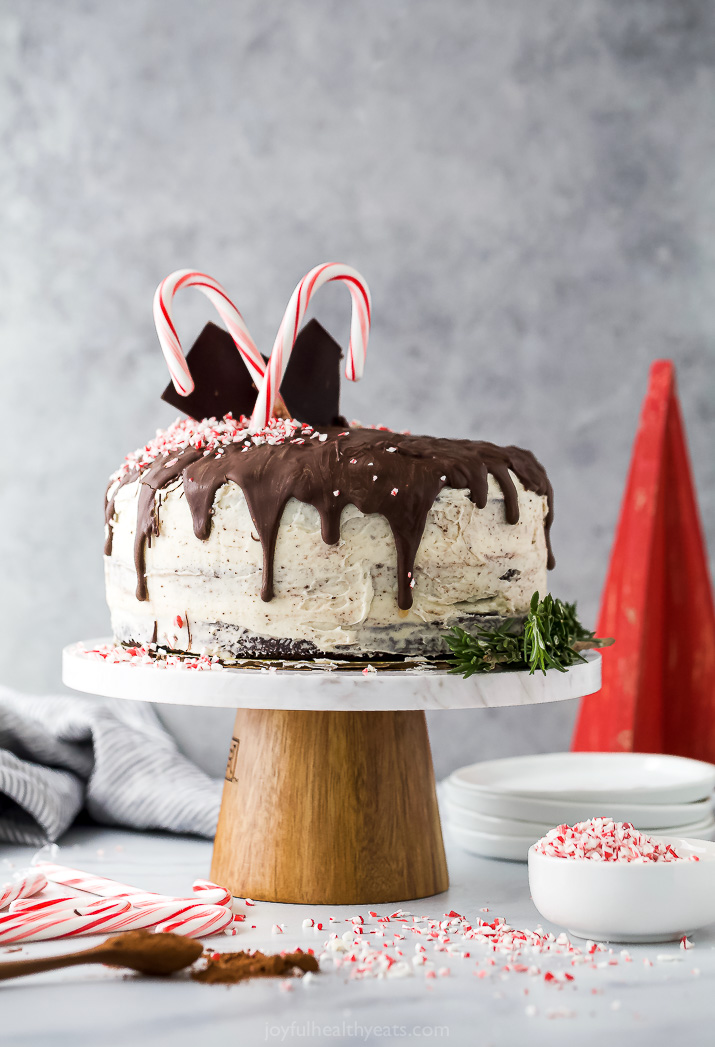 vegan chocolate cake with peppermint buttercream on a cake stand