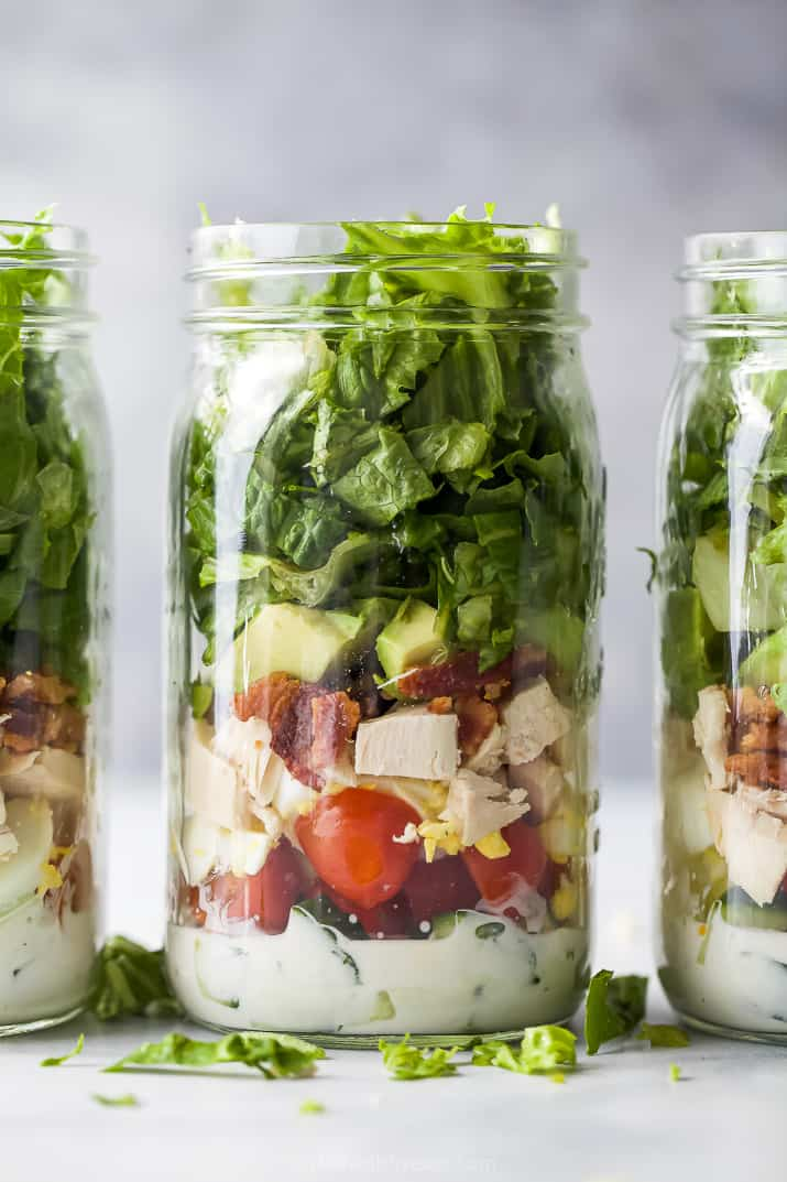 closeup of a mason jar filled with chicken cobb salad recipe with ranch dressing