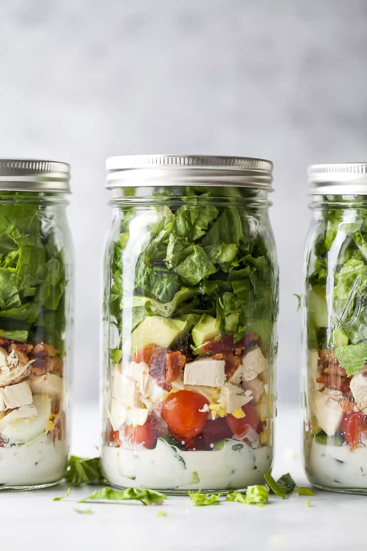mason jars filled with chicken cobb salad recipe with ranch dressing
