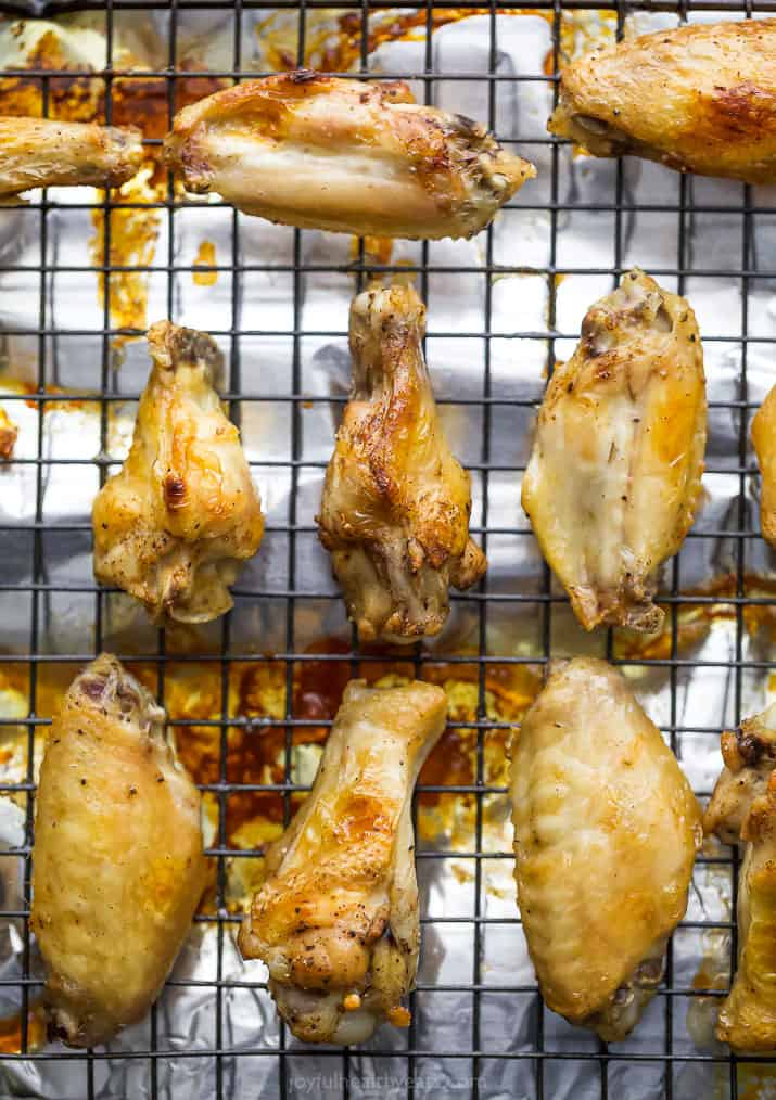 overhead photo of baked chicken wings on a baking sheet