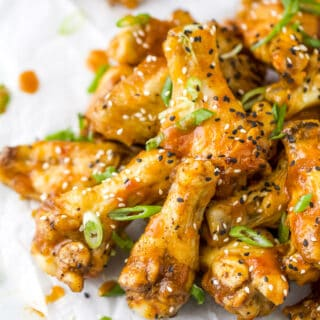 crispy baked korean bbq chicken wings with sesame seed and green onions