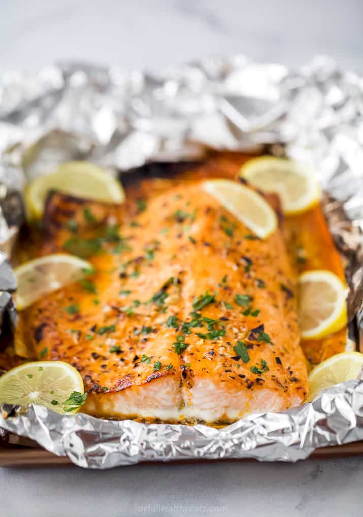 flaky baked salmon in tin foil with lemon slices