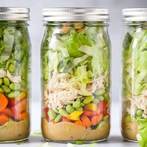 the best thai chicken mason jar salads with a spicy peanut dressing